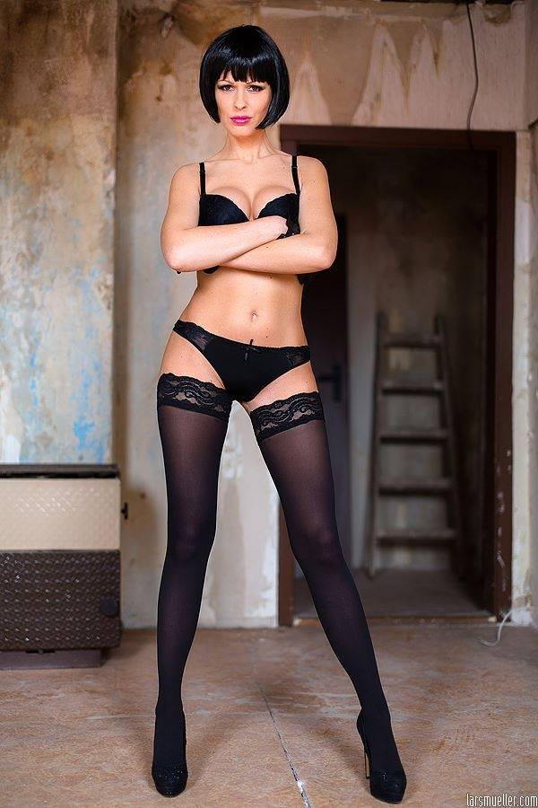 gorgeous american milf with short hair posing in black stockings and..